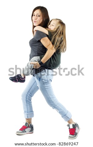 Mother giving her daughter a piggyback ride against white background