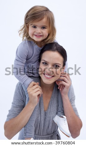 Mother giving her daughter piggyback ride at home