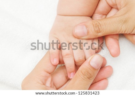 Mother hand massaging hand  of her baby,touch of Happiness