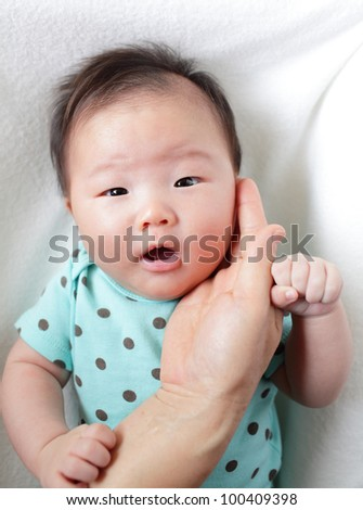 mother <b>hand touch</b> baby smile face, child are asian girl - stock-photo-mother-hand-touch-baby-smile-face-child-are-asian-girl-100409398