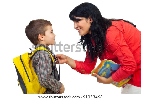 Mother having an conversation with her son before going to school and standing face to face isolated on white background - stock photo