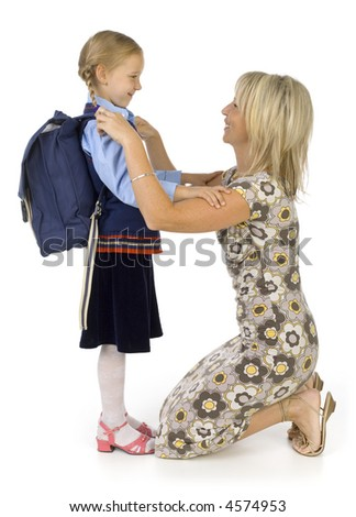 Mother helping her's young daughter prepare to school. Isolated on white in studio. Side view, whole body
