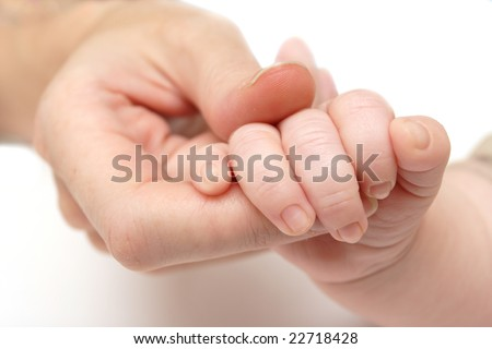 mother holding a baby`s hand in her hand
