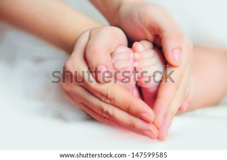 Mother holding baby's feet