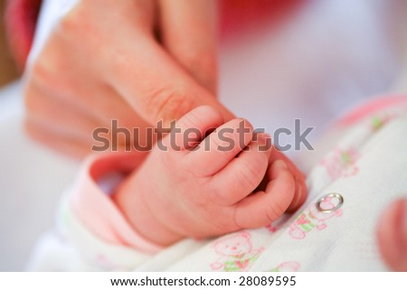 Mother holding her child's hand