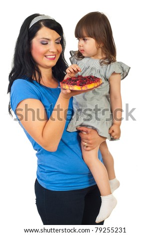 Mother holding her daughter and giving her a tart fruit isolated on white background