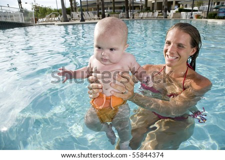 Mother Holding 6 Month Old Baby In Swimming Pool Stock Photo 55844374 Shutterstock