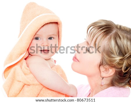 Mother holds baby in a towel