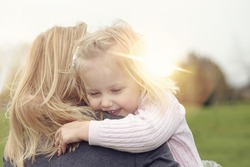 Mother hugging her baby daughter