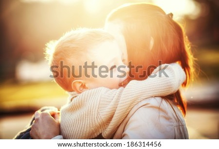 Mother hugging her child during walk in the park #186314456