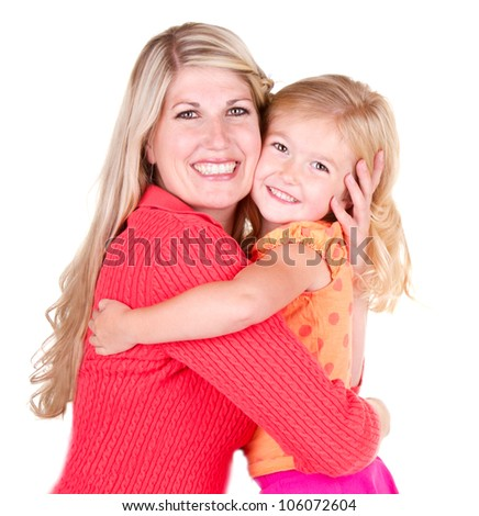 Mother hugging young daughter, isolated on white