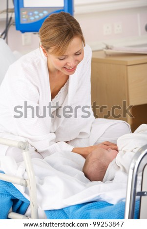 Mother in hospital with newborn baby