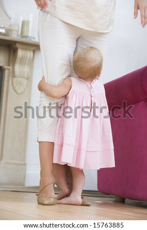 Mother in living room with baby
