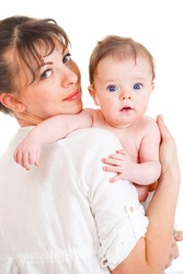Mother in white clothing holding baby son