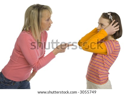 Mother is disciplining her 10-12yo daughter. Girl's stopping her ears. Side view. Isolated on white in studio.