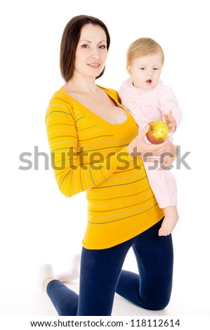 mother is feeding a baby apples isolated on white background