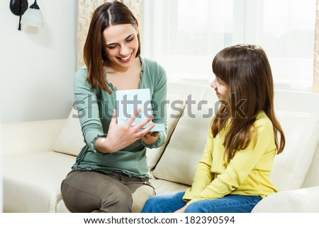 Mother is opening present from her daughter,she is very happy,it is just what she needed,You got it my dear,it`s exactly what I wanted!
