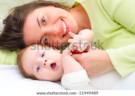 Mother keeps son in his hands - stock photo