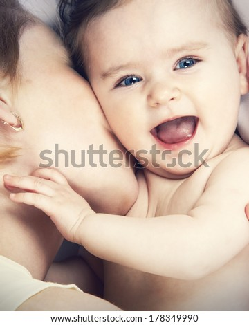 mother kissed her little baby close-up