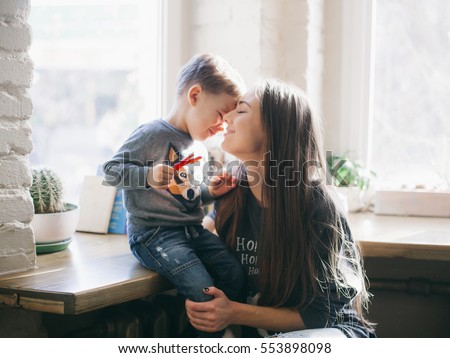 mother kissing her little son