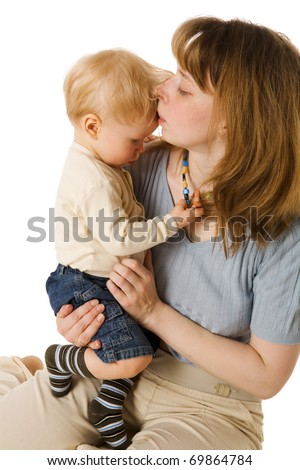 Mother kissing sick son's forehead isolated on white