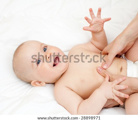 Mother massaging her child, shallow focus