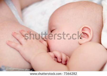 Mother nursing her new infant