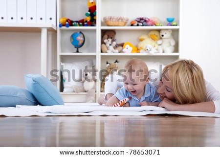 mother play in room with her baby