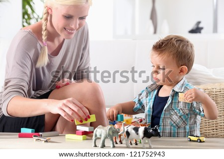 Mother playing with child