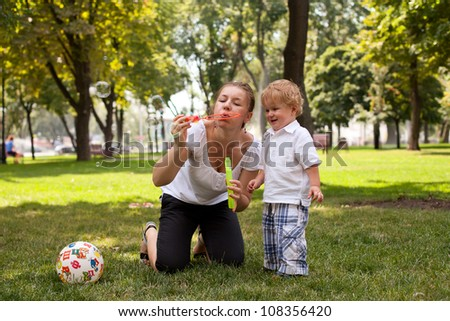 Mother playing with child   in the park