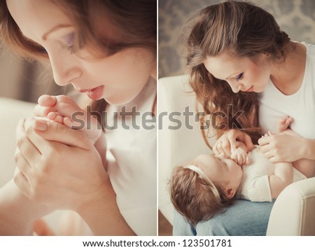 Mother playing with cute baby girl indoor