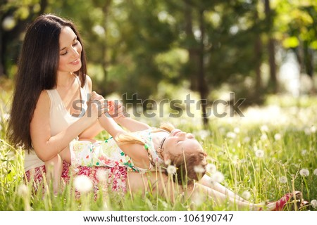 Mother playing with daughter in the park
