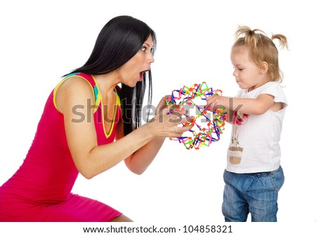 mother playing with her daughter. Isolated on the white background