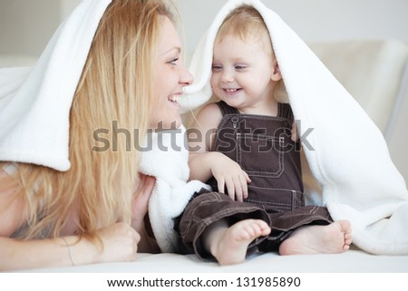 Mother playing with her toddler child at home
