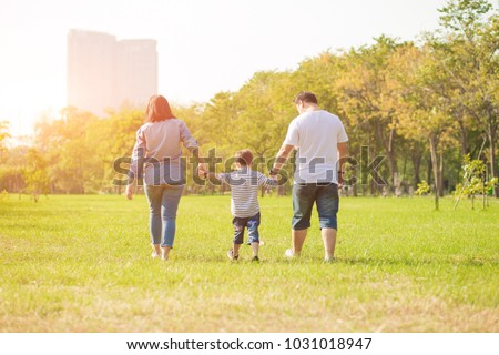 Mother playing with son  in the field. Happy family life style concept. - Shutterstock ID 1031018947