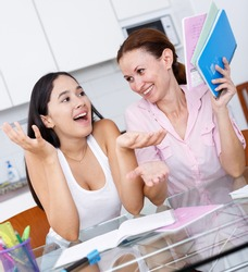 Mother pleased with her teenage daughter academic achievements