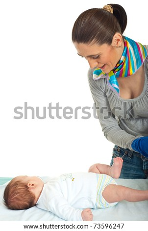 Mother prepare to change nappy to her newborn baby  against white background
