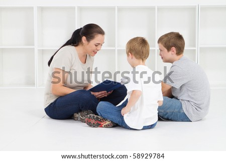 mother reading books to her kids