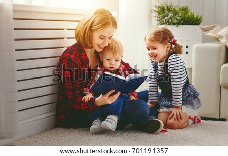Mother reads book to children son and daughter #701191357