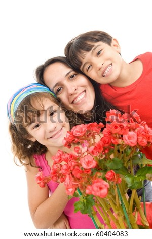 Mother receiving a flower from her kids .