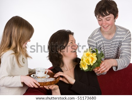 Mother receiving coffee and flowers on mother's day