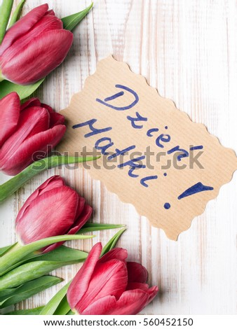 Mother's Day card and a bouquet of beautiful tulips on wooden background, with Polish words Mother's Day Zdjęcia stock ©
