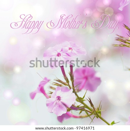 Mother's day card design featuring beautiful pink phlox flowers in the sunshine with bokeh and text, Happy Mother's Day.