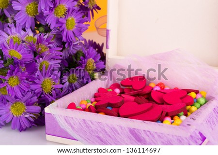 Mother's Day Concept present gift with colorful flowers and hearts