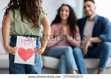 Mother's Day Gift. Cute Little Girl Prepared Greeting Card To Her Mom