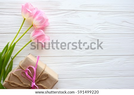 Mother's Day, woman's day. tulips ,presents  on wooden background #591499220
