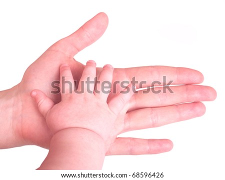 Mother's hand holding child's hand