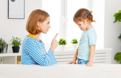 Mother scolds and punishes the child daughter