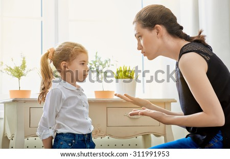 mother scolds her child