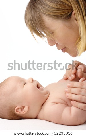Mother talking to her cheerful adorable child, isolated over white